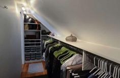 Jamie Bevec, professional closet designer with Closets by Design of Northern NJ, transformed a crawl space off her master bedroom into a long, well-organized closet.