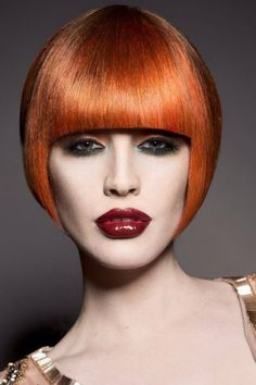 One length bangs with dramatic bob - red in color