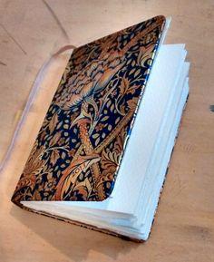 DIY watercolour sketchbook from an old hardback