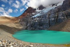 A beautiful turquoise glacier lake at the top of Cerro Castillo mountain. Blue sky with clouds. Places To Travel, Places To See, Chili, Glacier Lake, In Patagonia, Beautiful Places In The World, South America, Latin America, Travel Tips