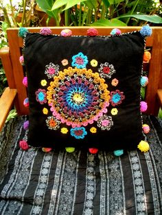 crochet cushion ~ crocheted embellishments on cushion cover - pom-poms too!crocheted embellishments on cushion cover - pom-poms too! Crochet Home, Love Crochet, Crochet Gifts, Crochet Motif, Crochet Flowers, Crochet Stitches, Knit Crochet, Crochet Patterns, Knitting Patterns
