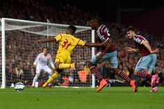 Liverpool's Raheem Sterling shoots during their English Premier League soccer match against West Ham United at Upton Park, London, Saturday, Sept. 20, 2014. (AP Photo/Tim Ireland)