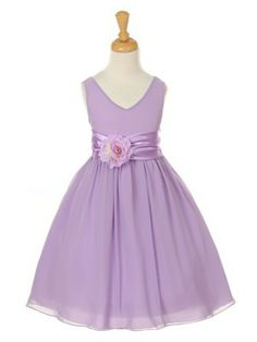Simple yet elegant looking dress made of soft Georgette. Lovely charmeuse waist is accented with a beautiful flower.