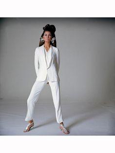 Editha Dussler in white pants suit by MicMac, Jane Bolles metallic earrings and silver sandals by Bernardo Vogue 1967 Bert Stern