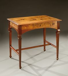 A mahogany and oak veneer desk with an exotic wood marquetry of thistles and floral motifs. Signed «Emile Gallé». Circa1900.