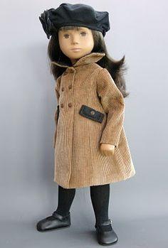 Sasha doll in tan coat