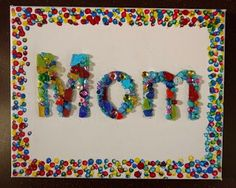 "I love this colorful Mother's Day mosaic collage craft idea. Use beads and other shiny materials to spell out the word ""Mom"" and use Q-ti..."