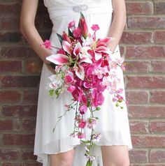 Cascading pink bridal bouquet.  Find real touch lilies and orchids at Afloral.com.  No one will believe your flowers aren't real!  Pinned by Afloral.com