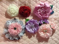 Flowers for Fiona's Flower Competition. The first two are chiffon fabric, the third one is paper, on the bottom row is lace, and the last two are ribbon.