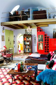 Red-EthnicStyle-Livingroom-Tiles-Pyrgos-Santorini-Dome-Pilows-Carpet-Fireplace-Loft-Colorful