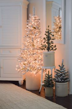 Get a Calm & Cozy Christmas Living Room: With Neutral, Glam Touches, Rustic Candle Options, Festive Throws and More. Flocked Christmas Trees, Small Christmas Trees, Cozy Christmas, Beautiful Christmas, Christmas Tree Decorations, Christmas Holidays, Xmas Trees, Farmhouse Christmas Trees, Christmas Tree Holder