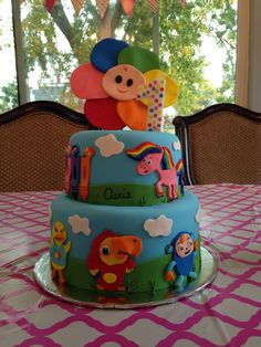 Babyfirst TV cake first birthday Tilley rainbow horse vocabularry color crew peekaboo blossom by Travis Parker