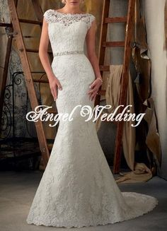 If you can't tell by now, I love lace vintage dresses. Especially high neck ones! Wedding Dress Vintage Lace Wedding Dress by AngelWeddingDress, $328.00