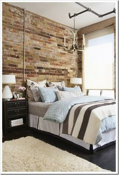 Hudson Bay Blanket. Great wall with awesome texture. Antler light fixture from metal pipe is a nice industrial touch.