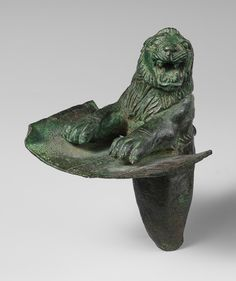 Foundation peg in the shape of the forepart of a lion, 2200–2000 BC. Probably Tell Mozan (ancient Urkish), northeastern Syria Bronze  After the collapse of the Akkadian empire and a brief period of decentralized rule, a dynasty ruling from the southern Mesopotamian city of Ur took over a large part of Mesopotamia, including areas in the Zagros Mountains of Iran, and ruled for about one hundred years (2100–2000 B.C.)