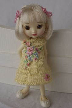 Tiny hand knit and embroidered floral dress for Amelia Thimble dolls. cindyricedesigns.com