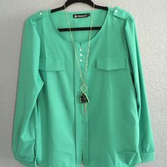 NEW~Beautiful Emerald Green Blouse NEW~Beautiful Emerald Green(1st pic) Blouse Buttons Decor Mock Pockets~Split Neck, Long Sleeves, Center Front Placket Slenderizes Button-tab Epaulets, Button Cuffs~casual but elegant. Pair it with a skirt or pants during the summer for almost any occasion! Definitely a Staple in your wardrobe ~ Great for BUNDLE'n! And Thank you so much for Visiting and Sharing!!  I have no fun ~ I ❤️ what I do! I ❤️ help'n people feel & lk Gr8t!  Blessings! Kelli ✝ Tops Blo...