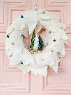 Anthropologie-Inspired Holiday Felt Wreath. Create a whimsical holiday wreath with layers of fluffy wool, felted balls and adorable tissue paper trees. Quilted Christmas Stockings, Crochet Christmas Trees, Felt Christmas, All Things Christmas, Tissue Paper Trees, Crafts To Make, Diy Crafts, Christmas Jingles, Felt Wreath