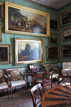 Gorgeous Gallery Room with paintings hanging on metal chains from one single brass bar - Breakfast Room, Calke Abbey, Derbyshire.