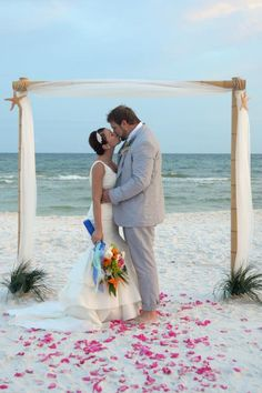 Bamboo wedding arbor with starfish and ivory fabric for your beach wedding in Santa Rosa Beach, Florida