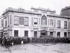 """June 1914 - Irish Citizen Army.     The Irish Citizens Army was formed during the Lockout to protect workers from the police, who had attacked their demonstrations. When the Lockout ended in January 1914 the Irish Cititzens Army original purpose was over, but it was about to play a major role in the Easter 1916 Rising.    The banner over Liberty Hall asserts the views of Irish socialists on the outbreak of the First World War - """"We Serve neither King nor Kaiser but Ireland"""""""