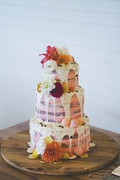 too-pretty-to-eat pink drip cake with edible giller and flowers
