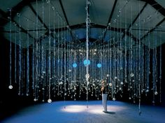 """Susan Hiller, Witness, 2000, Audio-sculpture: 400 speakers, wiring, steel structure, 10 CD players, switching equipment, lights; suspended from ceiling and walls, Approx 275 x 355"""""""