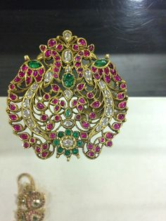 Traditional southindian cob ruby , uncut diam and emerald pendant in gold