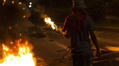 A teenager has been killed in Venezuela during another day of mass protests against President Nicolas Maduro officials say. Luis Alviarez 18 was hit in the chest during clashes with police in the western state of Tachira. Opposition activists say another protester was also killed in the state.