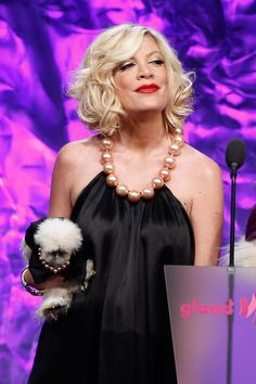 Coco Chanel, A Silkie Bantam Chicken Tori Spelling put a dress on a chicken and took her to an awards show in the world. This is that chicken.