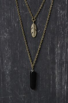 Welcome to Ananke Jewelry :) This is a handmade, boho style layered necklace for trendy & natural look. A perfect gift for any occasion! The short necklace has a little feather pendant and the long one has a Black Agate gemstone pendant. Both layers are connected to one clasp. Antique brass chains & findings. If you wish to have this necklace as a set of two, so you can wear each separately, just note it at checkout…