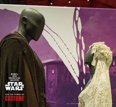 "Feel the sparks flying? Though faceless, the mannequin ""couple"" in the Smithsonian traveling exhibition ""Rebel, Jedi, Princess, Queen: Star Wars™ and the Power of Costume"" seem to be very enamored with each other. The couple is dressed in the original attire the actors wore in ""Attack of the Clones."" The Smithsonian traveling exhibition is the very first the wedding dress has been on public display.   http://www.powerofcostume.si.edu. Courtesy EMP Museum/Photo detail by John Lill"