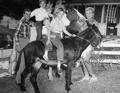 B'day celebrant Eve Arden with her husband actor/producer Brooks West and their 4 kids, Liza on the horse with brother Duncan, Connie with brother Doug on the back of the burro at their ranch in Hidden Vallley (near Los Angeles) - in the early 60s.