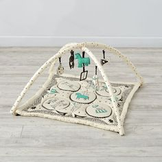 Shop Ringmaster Baby Activity Gym.  Little ones will love to explore and play on this baby activity gym designed by artist Roxy Marj.  The plush mat is made from soft cotton and topped with playful animals.