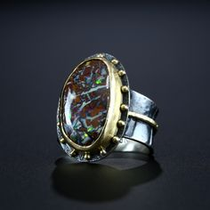 Opalized Petrified Wood Ring. Fabricated Sterling Silver and 18k Gold. www.amybuettner.com https://www.facebook.com/pages/Metalsmiths-Amy-Buettner-Tucker-Glasow/101876779907812?ref=hl https://www.etsy.com/people/amybuettner http://instagram.com/amybuettnertuckerglasow