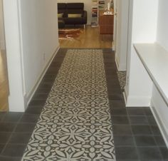 Patterned cement tiled floor with solid border.