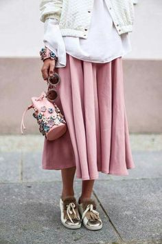 pink midi skirt with floral appliqué handbag