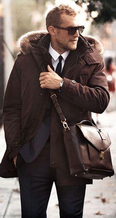 Shop this look on Lookastic:  http://lookastic.com/men/looks/sunglasses-dress-shirt-tie-parka-blazer-messenger-bag-dress-pants/7983  — Black Sunglasses  — White Dress Shirt  — Black Tie  — Dark Brown Parka  — Navy Blazer  — Dark Brown Leather Messenger Bag  — Black Dress Pants