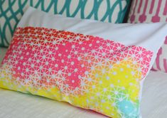 one white pillow case + some fabric paint + a metal grate =  one fun throw pillow