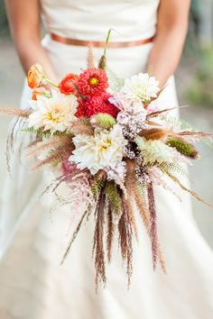 bright fall bouquet - photo by Haley George Photography http://ruffledblog.com/best-of-2014-bouquets #weddingbouquet #flowers