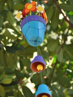 Create Colorful Wind Chimes - Transform tiny terra-cotta pots into cheery music for your garden. These chimes are constructed entirely by knotting and gluing — no drilling required! Garden Crafts, Garden Art, Garden Ideas, Garden Projects, Music Garden, Clay Pot Crafts, Diy Crafts, Diy Clay, Ideas Para Decorar Jardines