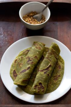 aloo palak parathas – whole wheat flat bread made with mashed potatoes and spinach puree. step by step recipe.  #parathas
