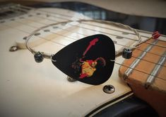 Recycled Guitar String Bracelet - Jimi HendrixSilver with Black Jimi Hendrix Guitar Pick AccentNickle Plated Guitar Strings, Tarnish Free!