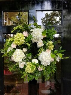Wedding wreath of hydrangea and roses.   In bloom, ltd.
