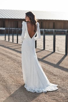 Bea wedding dress | One Day Bridal | CHOSEN – New Reign Collection 2018 | A relaxed style bridal gown with a statement sleeve, low back and split. The Bea wedding gown is covered in a delicate fine lace.