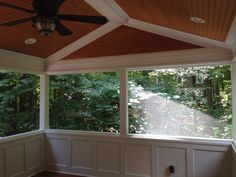 Screen porch with wainscoting knee walls, custom tongue and groove ceiling