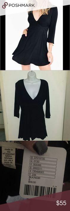 BNWT Silence + Noise V-Neck Black Dress Brand New With Tag  Silence + Noise V-Neck Black Dress with 3/4 Sleeves 65% Polyester 35% Rayon 5% Spandex silence + noise Dresses Mini