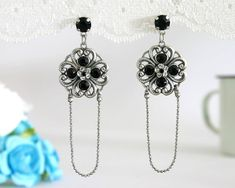 Long Silver Flower Earrings With Black And White Crystals - Filigree Jewelry - Elegant Jewelry - Classic Jewelry   Francis - is all about flowers and romance from the past. It is made of Antique Silver plated brass and combine with black and white Swarovski crystals.  A very delicate chain was swings romanticaly from the bottom of the pendant. $72