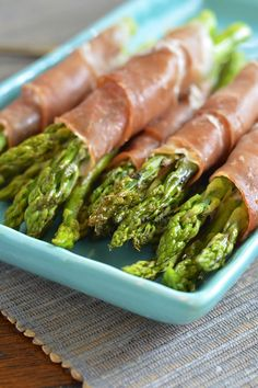 Asparagus wrapped in prosciutto and garlicky goat cheese is the perfect side dish for any special occasion dinner. Thanksgiving Side Dishes, Thanksgiving Recipes, Cooking Recipes, Healthy Recipes, Ww Recipes, Pork Recipes, Dinner Recipes, Cheese Wrap, Prosciutto Wrapped Asparagus