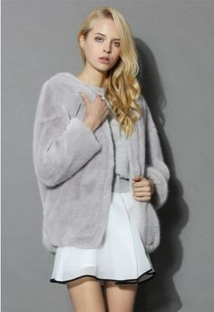 Relax glamorously at the next kick-back gathering with this ultra comfy faux fur coat! Throw this pretty piece of outerwear over all of your neutral monochromatic looks for a luxe finish!  - Super soft faux fur finished - Open front - Drop shoulder design - Side pockets - Shell: 80% Modacrylic, 20% Acrylic; Lining: 100% Polyester - Dry clean only  Size(cm) Length  Bust   Waist  Shoulder  Sleeves XS        71    Free    Free     63      43 S         71…